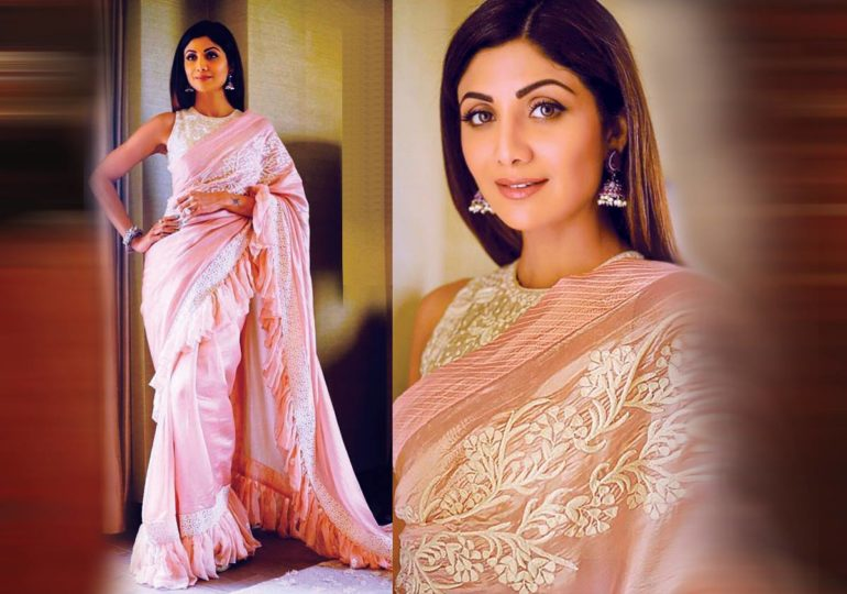 4b823a2ad7 Dressed in a salmon pink sari with girly frills, a svelte Shilpa Shetty  turned heads with her rather outlandish fashion choice at Young FICCI  Ladies ...